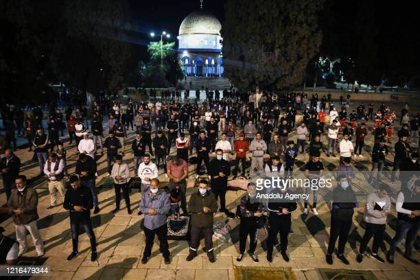 Palestinian Muslims perform dawn prayer at Masjid Al-Aqsa after reopened following its closure more than two months due to the novel coronavirus...
