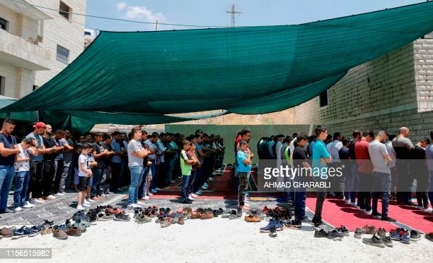Palestinian Muslims perform Friday prayers at a protest tent in the Wadi alHummus area adjacent to the Palestinian village of Sur Baher in East...