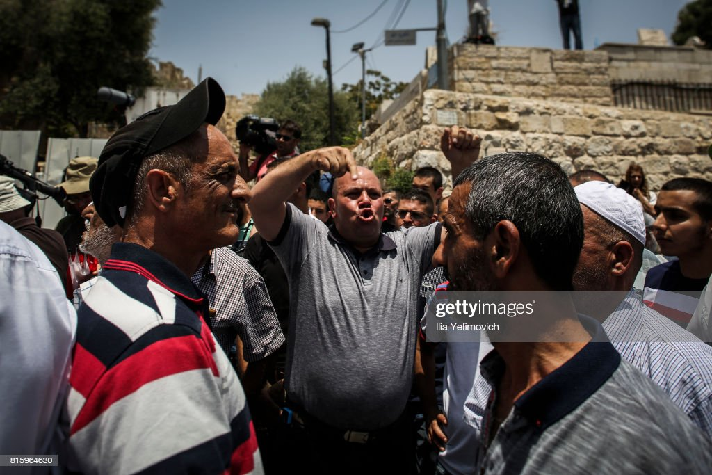 Palestinian Muslims protest outside the entrance to the old city of Jerusalem as it is partially blocked by Israeli Police on July 17, 2017 in Jerusalem, Israel. Following Friday's terror attack the holy site of Al Aqsa mosque was partly closed. Now only individuals can enter through metal detectors which has sparked outrage in the Muslim community.
