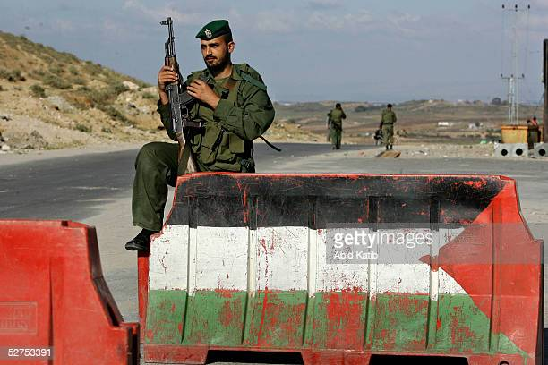 Palestinian national security guard patrols the road that links the Beit Lahyea Refugee Camp and the Israeli settlement of Nesaneit May 3 2005 in the...