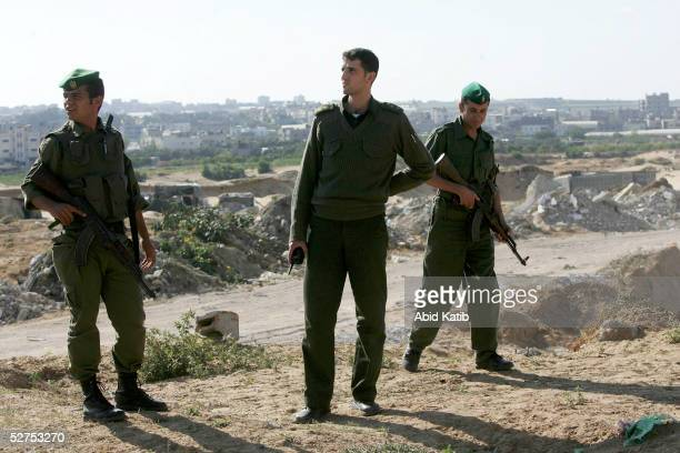 Palestinian national security patrols the road that links the Beit Lahyea Refugee Camp and the Israeli settlement of Nesaneit May 3 2005 in the...