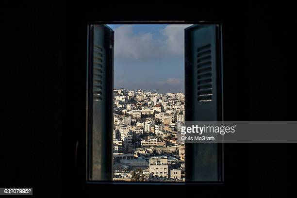 Palestinian neighbourhood is seen from the window of a building inside an Israeli settlement in the city of Hebron on January 18 2017 in Hebron West...