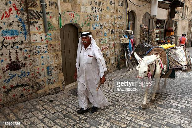 A Palestinian oil vendor walks with his donkey in the Muslim Quarter of Jerusalem's Old City on May 10 2010 Most Palestinians in east Jerusalem...