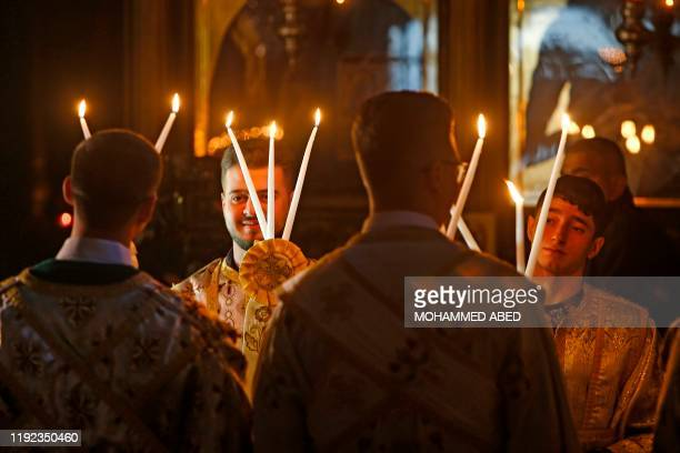 Palestinian Orthodox altar boys take part in a Christmas Mass at the Church of Saint Porphyrius in Gaza City on January 7 2020