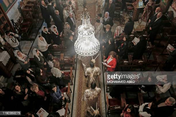 Palestinian Orthodox Christians attend a Christmas Mass at the Church of Saint Porphyrius in Gaza City on January 7 2020