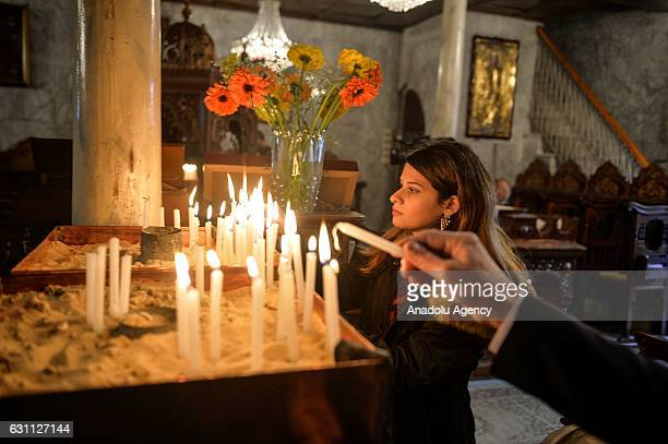Palestinian Orthodox Christians attend a Christmas mass at the GreekOrthodox Saint Porfirios church in Gaza City on January 7 2017 The Orthodox...