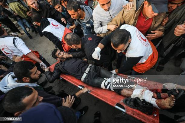 "Palestinian paramedics carry a wounded person after Israeli intervention in a ""Great March of Return"" demonstration near Al Bureij Refugee Camp on..."