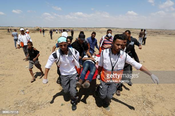 Palestinian paramedics carry an injured protestors after Israeli security forces' intervention to a protest organized after Razan Ashraf Najjar a...