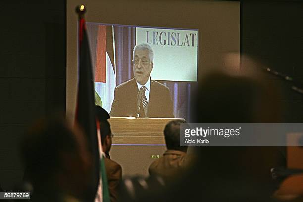 Palestinian Parliament elected members listen to outgoing Palestinian President Mahmud Abbas give a speech seen on a videolink during the inaugural...