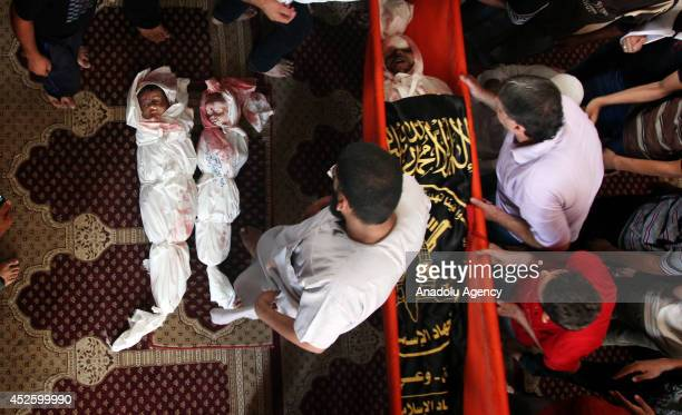 Palestinian people attend the funeral ceremony of Abdulhadi Abdulnabi and Abdullah Abdulnabi brothers, killed in ongoing Israeli shelling within the...