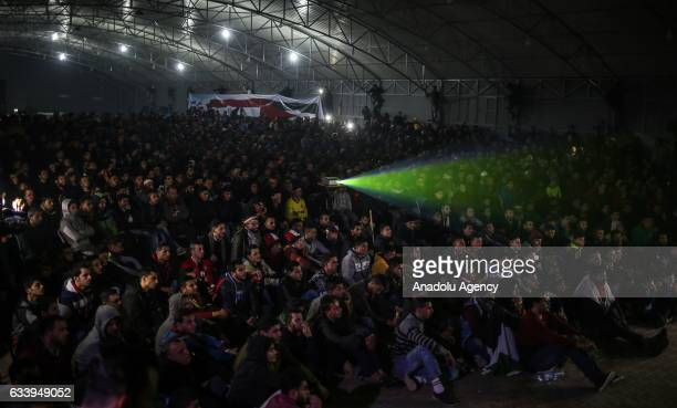 Palestinian people watch the 2017 Africa Cup of Nations final match between Cameroon and Egypt at EsSaraya sports center in Gaza City Gaza on...