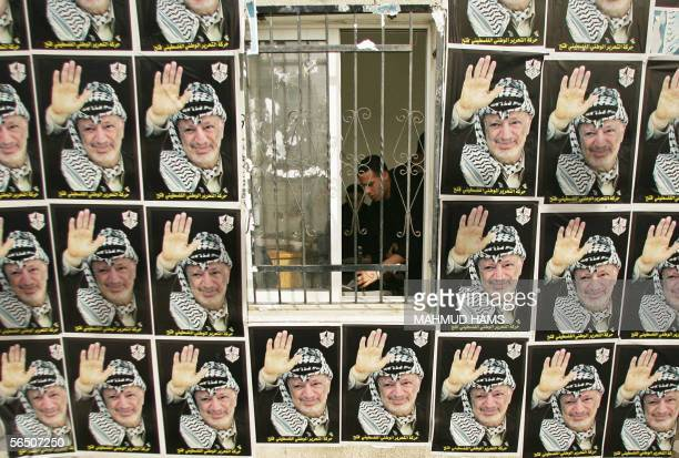 Palestinian policeman is seen inside his office during a rally to celebrate the 41th birthday of the Fatah movement's creation in Gaza City 31...
