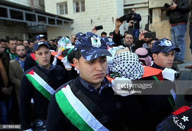 Palestinian policemen carry the body of Palestinian police officer Amjad Sukkari who has been killed by Israeli soldiers during the funeral ceremony...