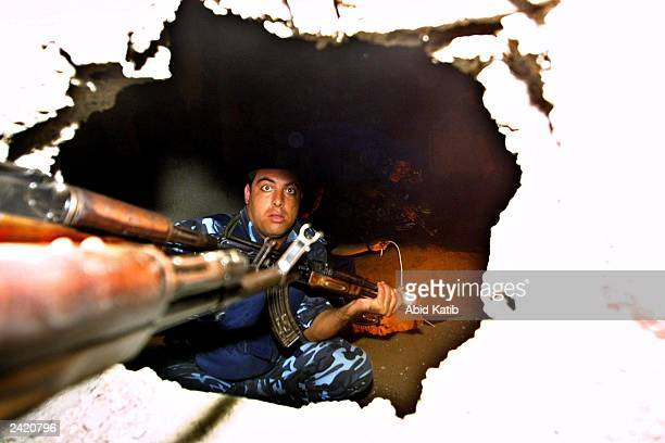 Palestinian policemen search for tunnels under the border linking the Gaza Strip and Egypt, August 23 in Rafah Refugee Camp in the southern area of...
