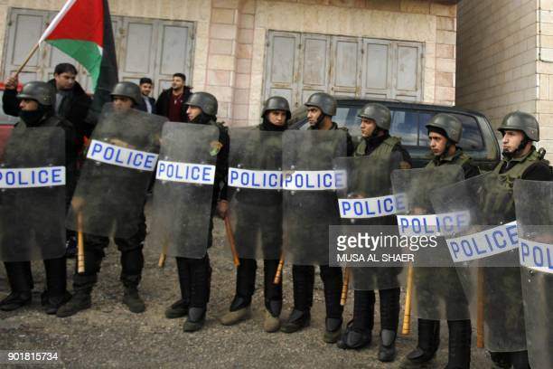 Palestinian policemen stand guard as the convoy of Jerusalem's Greek Orthodox patriarch Theophilos III arrives in the West Bank town of Bethlehem on...