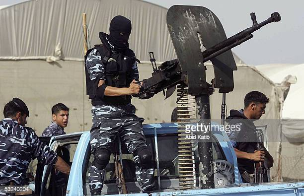 Palestinian policemen take up positions near to their post in the Deir AlBalah refugee camp in an effort to prevent further rocket attacks on Israeli...
