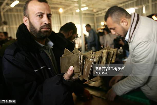 Palestinian policemen who are loyal to Hamas display confiscated marijuana dried Bango plants cocaine in the police headquarters on December 9 in...