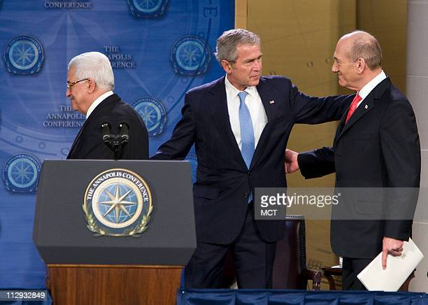 Palestinian President Mahmoud Abbas and Israel's Prime Minister Ehud Olmert and President George W Bush leave the stage following remarks at the...