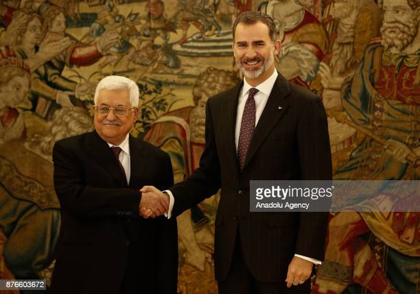 Palestinian President Mahmoud Abbas and King Felipe VI of Spain shake hands as they pose for a photo at Palace of Zarzuela in Madrid Spain on...