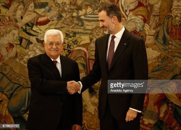 Palestinian President Mahmoud Abbas and King Felipe VI of Spain shake hands as they gesture at Palace of Zarzuela in Madrid Spain on November 20 2017