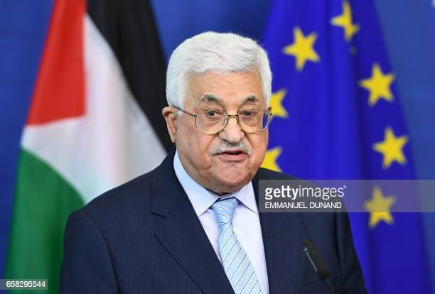 Palestinian President Mahmoud Abbas arrives to make a statement at the European Commission in Brussels on March 27, 2017. / AFP PHOTO / EMMANUEL...