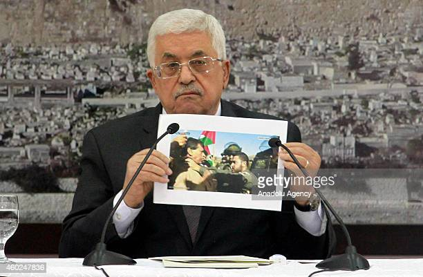 Palestinian President Mahmoud Abbas attends an extraordinary meeting with the members of the Palestine Liberation Organization after the death of...