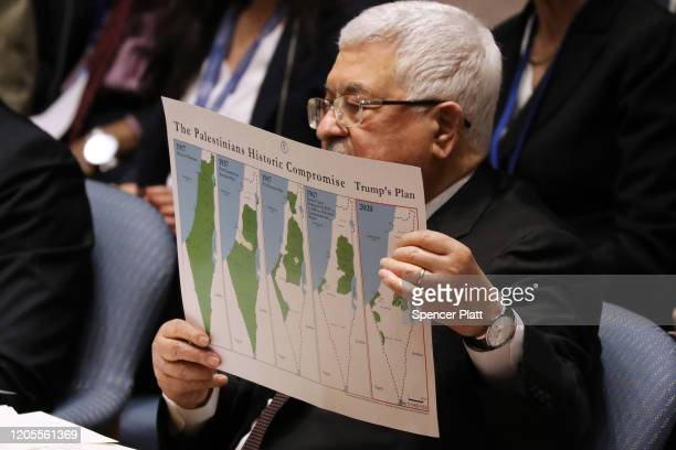 Palestinian President Mahmoud Abbas holds up a Vision for Peace map while speaking at the United Nations Security Council on February 11, 2020 in New...