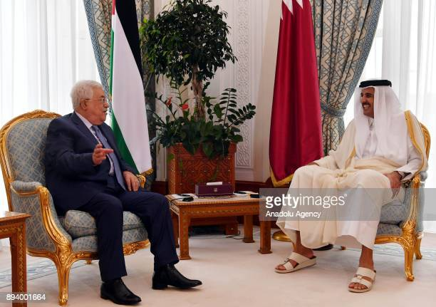 Palestinian President Mahmoud Abbas meets with Emir of Qatar Sheikh Tamim bin Hamad Al Thani during his official visit in Doha Qatar on December 17...