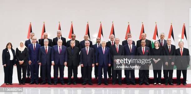 Palestinian President Mahmoud Abbas poses for a photo with Fatah Movement Central Committee member Muhammad Shtayyeh and new cabinet members after...