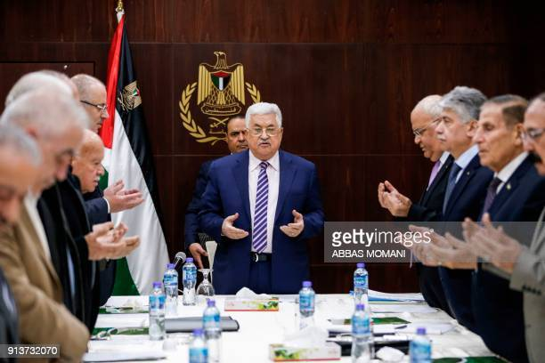 Palestinian president Mahmoud Abbas recites a prayer prior to chairing a meeting of the Palestine Liberation Organization Executive Committee at the...