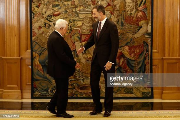 Palestinian President Mahmoud Abbas shakes hands with King Felipe VI of Spain during their meeting at Palace of Zarzuela in Madrid Spain on November...