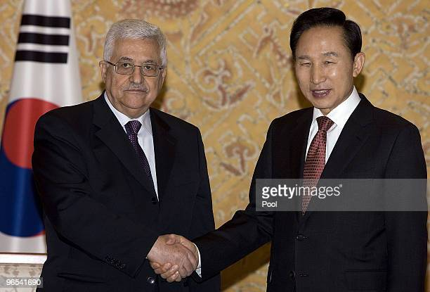 Palestinian President Mahmoud Abbas shakes hands with South Korean President Lee MyungBak at the presidential blue palace on February 10 2010 in...