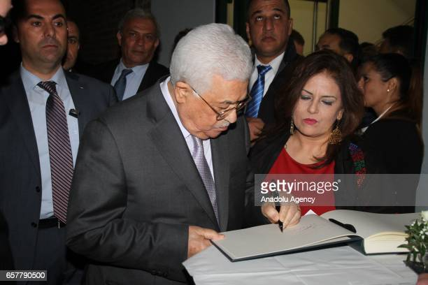 Palestinian President Mahmoud Abbas signs the guest book during the 12th Steiger Award Ceremony in Dortmund Germany on March 25 2017
