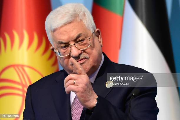Palestinian President Mahmoud Abbas speaks as he holds a press conference following the Extraordinary Summit of the Organisation of Islamic...
