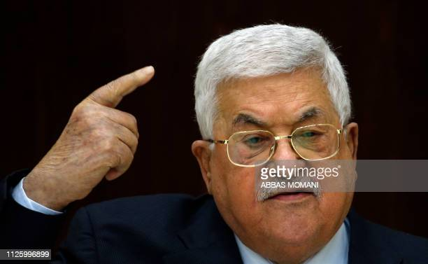 Palestinian President Mahmoud Abbas speaks during a meeting with Palestinian leaders at the Muqata, the Palestinian Authority headquarters, in the...