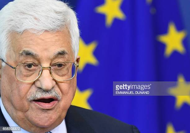 Palestinian President Mahmoud Abbas speaks during a press conference at the European Commission in Brussels on March 27, 2017. / AFP PHOTO / EMMANUEL...