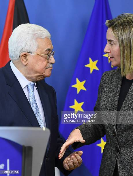 Palestinian President Mahmoud Abbas speaks with EU foreign policy chief Federica Mogherini during a press conference following their meeting at the...