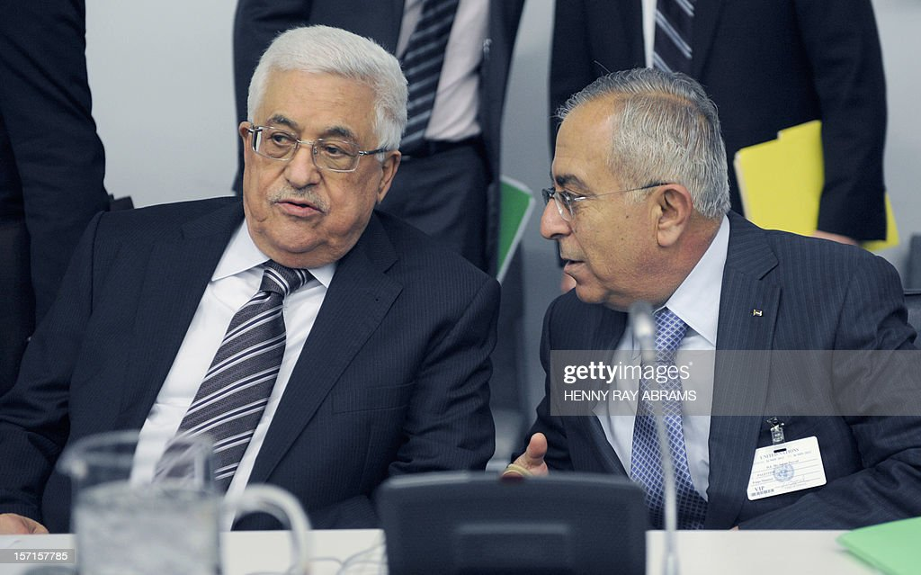 Palestinian President Mahmoud Abbas (L) talks to Palestinian Prime Minister Salam Fayyad prior to a meeting of the Committee on the Exercise of the Inalienable Rights of the Palestinian People, November 29, 2012 at UN headquarters in New York. AFP PHOTO/Henny Ray Abrams