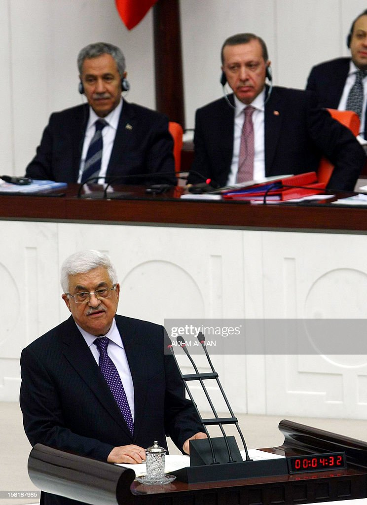 Palestinian president Mahmud Abbas addresses the Turkish Parliament in Ankara on December 10, 2012. The UN General Assembly overwhelmingly backed a resolution to recognise Palestine as a non-member observer state, a move Abbas said on December 5, 2012 was part of 'a last chance' for a negotiated two-state solution. Turkey welcomed the upgrading of the Palestinians' status as a 'significant step', with Foreign Minister Ahmet Davutoglu calling for an independent Palestinian state with east Jerusalem as its capital. In background, at right, Turkish Prime Minister Recep Tayyip Erdogan.
