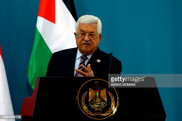 Palestinian president Mahmud Abbas and his Austrian counterpart attend a joint press conference following their meeting in the West Bank city of...