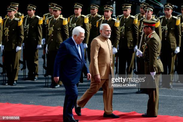 TOPSHOT Palestinian president Mahmud Abbas and Indian Prime Minister Narendra Modi review the honour guard ahead of their meeting in the West Bank...
