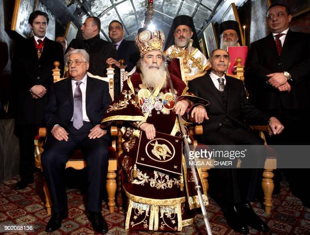 Palestinian president Mahmud Abbas and Jerusalem's Greek Orthodox patriarch Theophilos III attend the Christmas Midnight Mass for the Greek Orthodox...