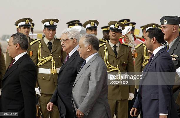 Palestinian president Mahmud Abbas is greeted by Libyan Prime Minister Baghdadi alMahmudi upon his arrival at the airport in the Libyan coastal city...