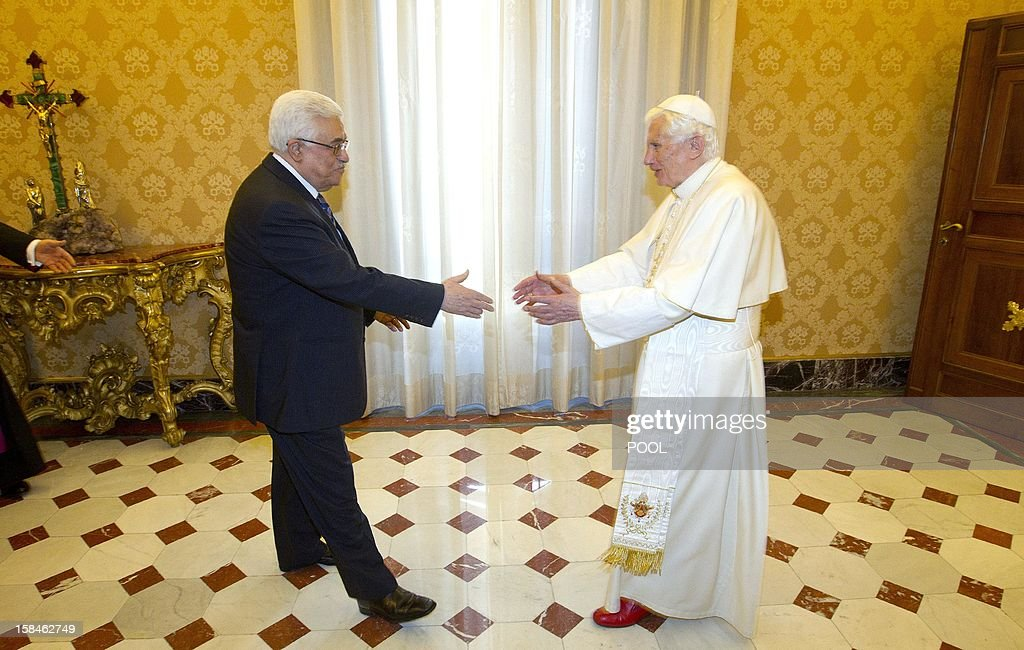 Palestinian president Mahmud Abbas (L) is greeted by Pope Benedict XVI during a private audience on December 17, 2012 at the pontif's library at the Vatican.