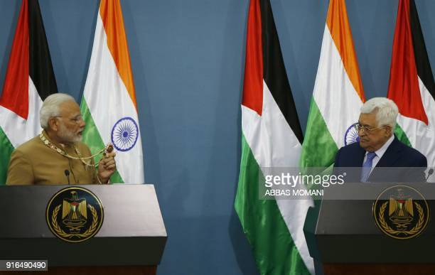 Palestinian president Mahmud Abbas listens to Indian Prime Minister Narendra Modi during their joint press conference following their meeting in the...