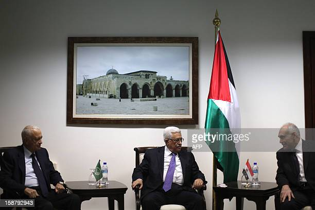 Palestinian president Mahmud Abbas meets with Arab League Secretary General Nabil alArabi and Egyptian Foreign Minister Mohamed Kamel Amr upon their...