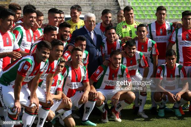 "Palestinian President Mahmud Abbas , poses with players of Chilean football club ""Palestino"", during a visit to their stadium in Santiago, on May 10,..."