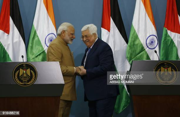 TOPSHOT Palestinian president Mahmud Abbas shakes hands with Indian Prime Minister Narendra Modi during a joint press conference following their...