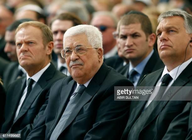 TOPSHOT Palestinian president Mahmud Abbas sits alongside European Council President Donald Tusk and Hungary's Prime Minister Viktor Orban at...