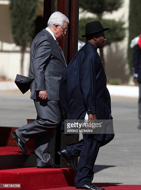 Palestinian president Mahmud Abbas walks near Nigerian President Goodluck Jonathan during a welcoming ceremony ahead of a meeting on October 29 2013...